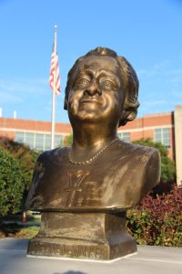 Bust of Maggie Walker in front of MW