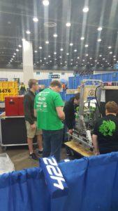 Students unpacking team robot