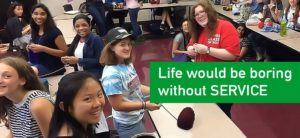 Students helping in a classroom. Caption reads life would be boring without service