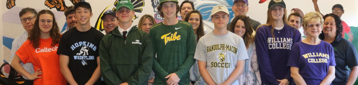 Student athletes at college signing