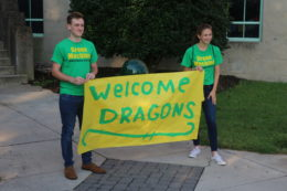 2 Students holding Welcome Banner