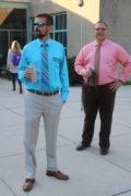 Assistant Director and Director observe student arrivals