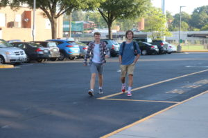 Two male students arrive on first day of school
