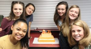 6 Female Students around a cake