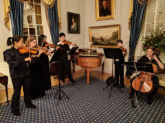 Students perform music at the Governor's mansion