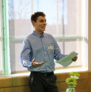 1 man presenting scholarship award
