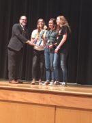 3 students receiving team award