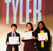 3 students holding certificate awards