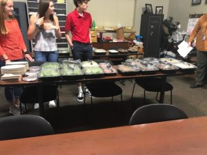 Food table as students serve police officers